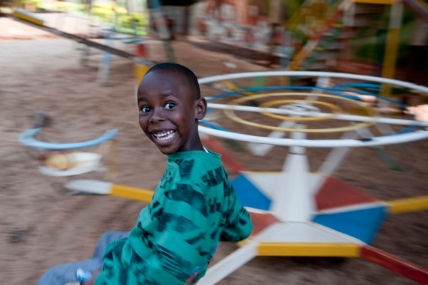 Freddy enjoying the playground at Brian's Uncle's resort in Mukurwe-ini.