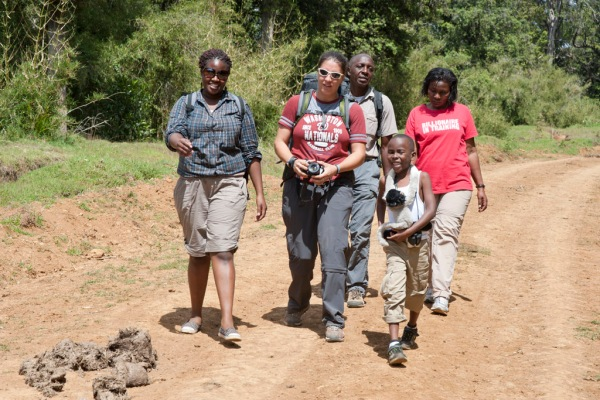 Barbra, Eugenia, Njenga, Freddy, Maito, and Tristan veer to the left to avoid a little elephant dung.