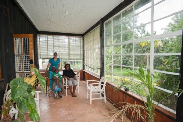 Eugenia, Shosho, Freddy and Maito relax in the sunroom before we tour the estate.