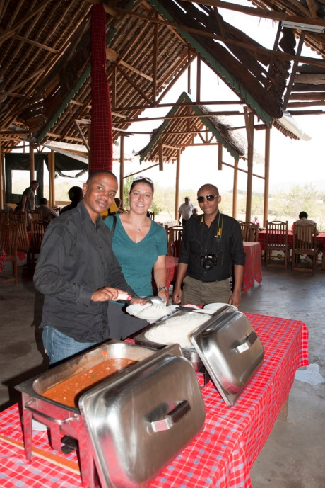 Gachanja, Eugenia and Charles getting dinner back at camp.