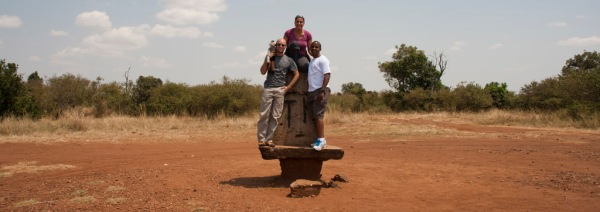 Eugenia, Gachanja, Tristan and I standing on the border of Tanzania and Kenya, where the Serengeti National Park borders the Mara.
