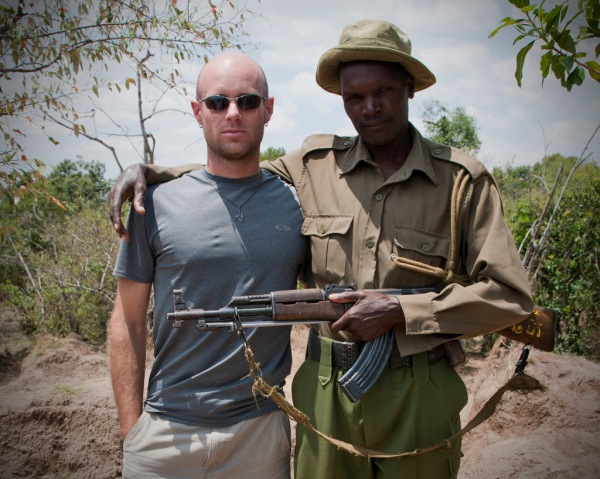 Posing with one of the park rangers who will accompany us on our hike along the Mara River.