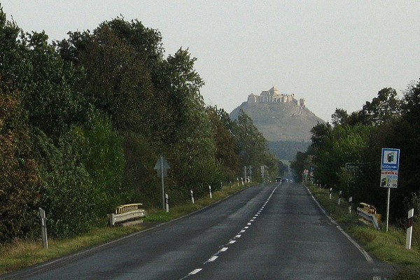 Sümeg Castle rises in the distance.