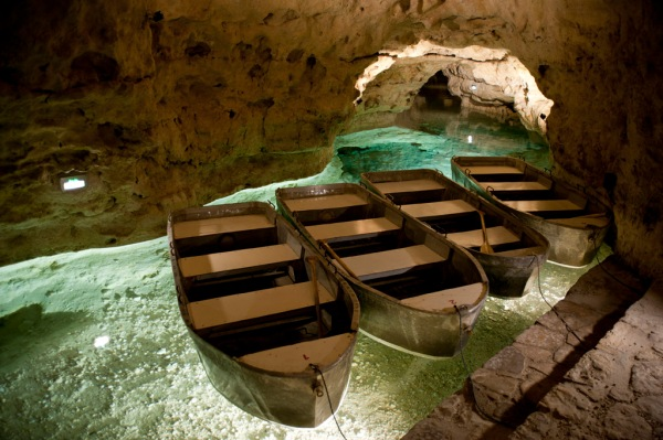 Inside the Lake Cave of Tapolca, a 5 km (3 mi) long limestone cave just under the city. 180 m (600 ft) of that length can be traveled through by boat.