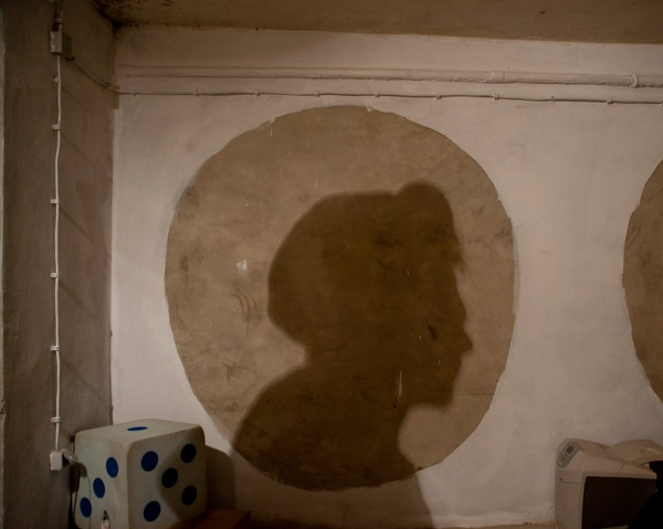 Či Ćo's silhouette on the basement wall, where soon they will paint murals.
