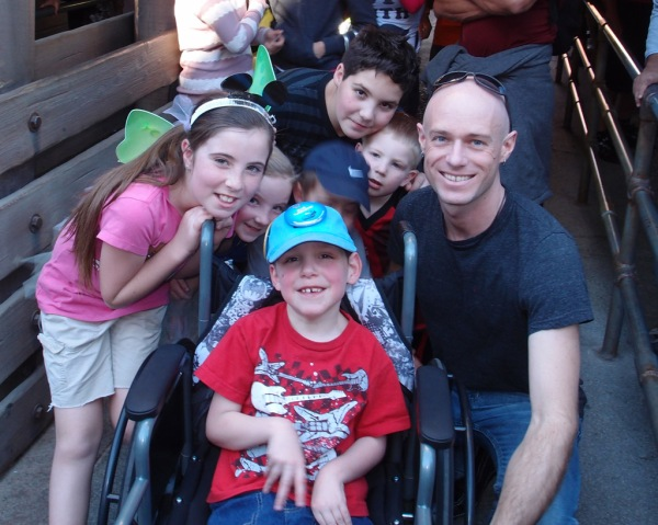 Corly, Devony, Tayt, Jace, Gage, Jackson and Uncle Ryan in line for the Cars ride.