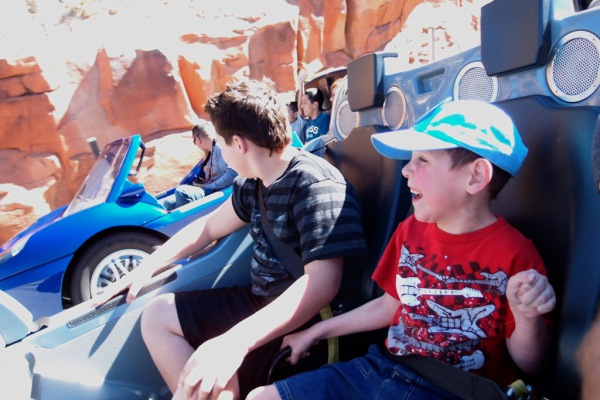 Gage and Tayt cheer as we gain on the car we're racing.