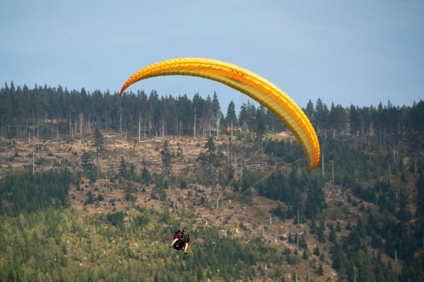 Watching para-gliders enjoy a perfect day of flying in the Krkonoše Mountains.